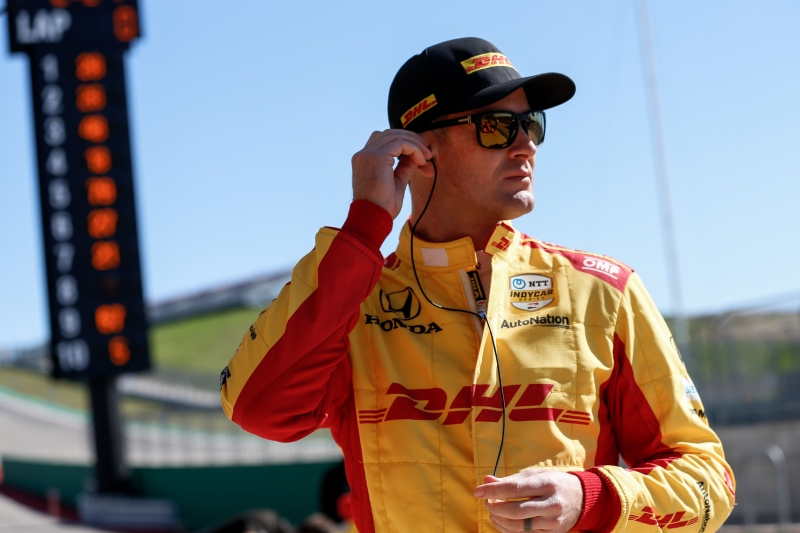 Ryan Hunter-Reay sets his earpieces along pit lane during the Open Test at Circuit of The Americas -- Photo by: Joe Skibinski