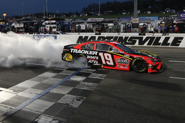 MARTINSVILLE, VIRGINIA - APRIL 11: Martin Truex Jr., driver of the #19 Bass Pro Toyota, celebrates with a burnout after winning the NASCAR Cup Series Blue-Emu Maximum Pain Relief 500 at Martinsville Speedway on April 11, 2021 in Martinsville, Virginia. (Photo by James Gilbert/Getty Images)